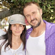 Courtney Cox, with husband David Arquette, sports one of Alternative's signature hats.