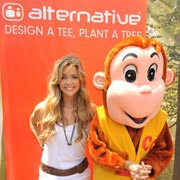 Denise Richards stands with a friend at Alternative's Green Forest booth.
